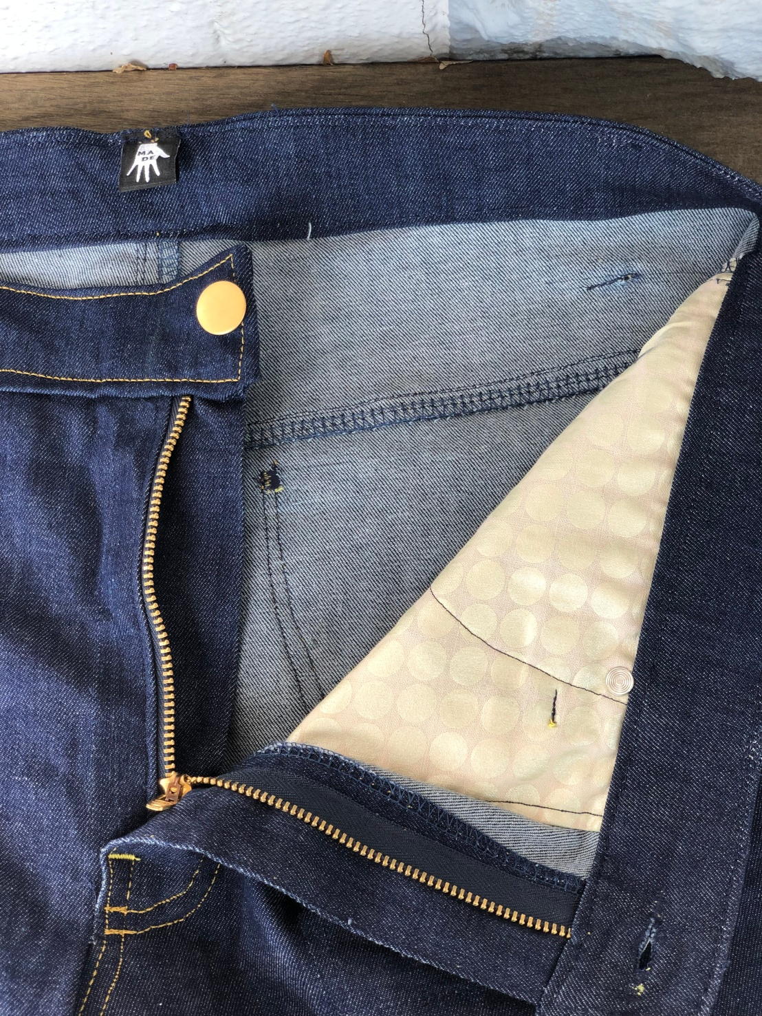 The inside of a pair of jeans showing the pocket fabric.
