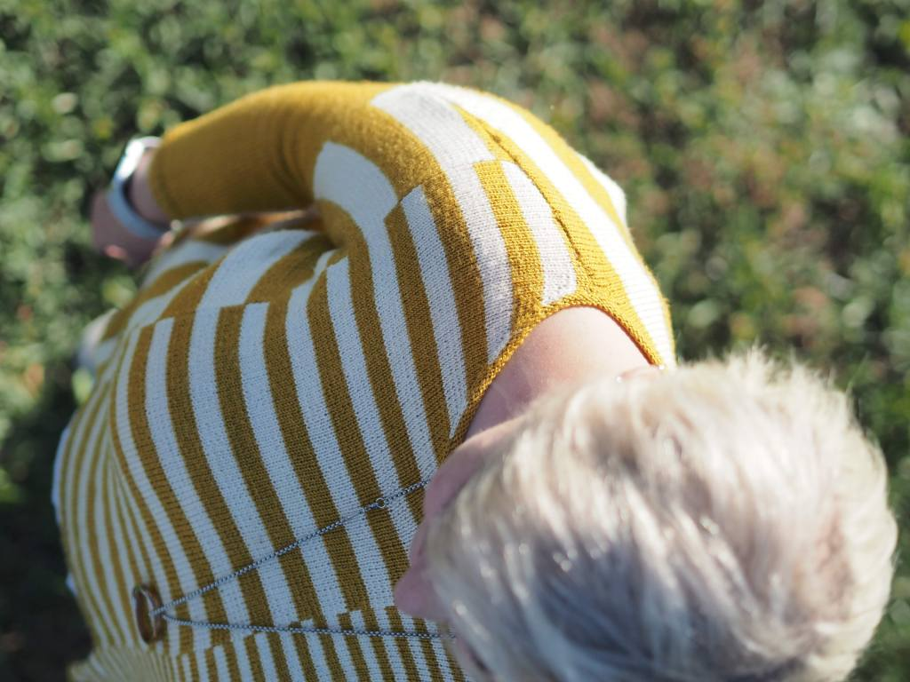 top down photo of the yellow striped sweater showing off the seaming junctions